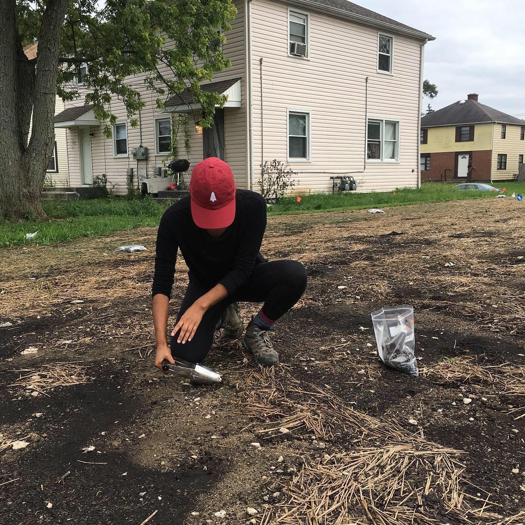 Man sampling soil